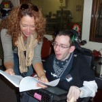 Beth and Jordan review the script before capturing some still shots from the station for the documentary.