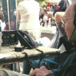 Ralph keeps an eye on the equipment during one of many remote radio broadcasts for WPAQ over the years.